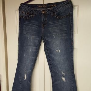 Flared Distressed Jeans with Stud Accents